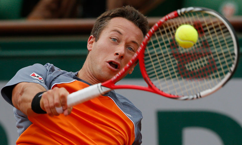 Germany's Philipp Kohlschreiber returns against Serbia's Novak Djokovic in their fourth round match at the French Open tennis tournament, at Roland Garros stadium in Paris, Monday June 3, 2013.  — AP Photo