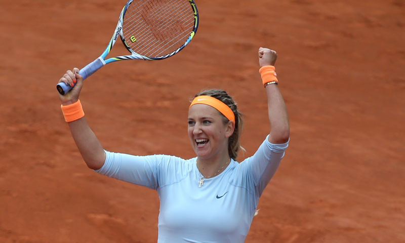Victoria Azarenka of Belarus celebrates as the ball goes out, defeating Italy's Francesca Schiavone in two sets 6-3, 6-0, their fourth round match at the French Open tennis tournament, at Roland Garros stadium in Paris, Monday June 3, 2013. — AP Photo