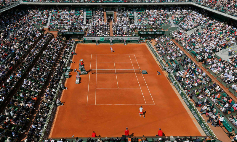 An aerial view shows Court Philippe Chatrier during the men's singles match between Rafael Nadal of Spain and Kei Nishikori of Japan at the French Open tennis tournament at the Roland Garros stadium in Paris June 3, 2013. — Reuters