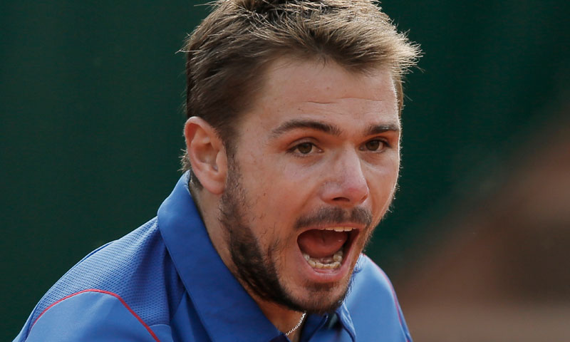 Switzerland's Stanislas Wawrinka celebrates after winning against Richard Gasquet of France in their fourth round match at the French Open tennis tournament, at Roland Garros in Paris, Monday June 3, 2013. — AP Photo