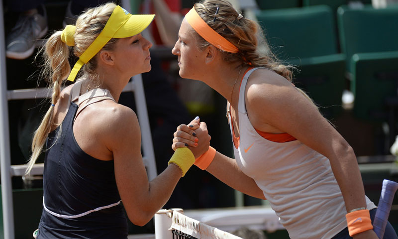 Victoria Azarenka kisses Maria Kirilenko after winning.— AFP Photo