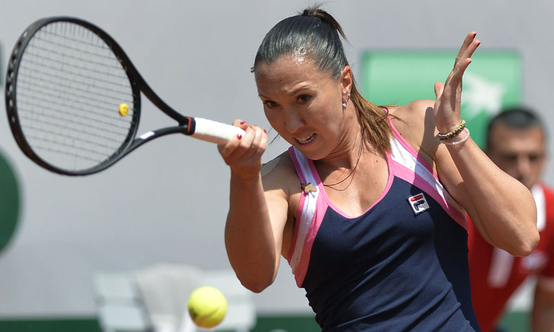 Jelena Jankovic returns a shot to Russia's Maria Sharapova.— AFP Photo