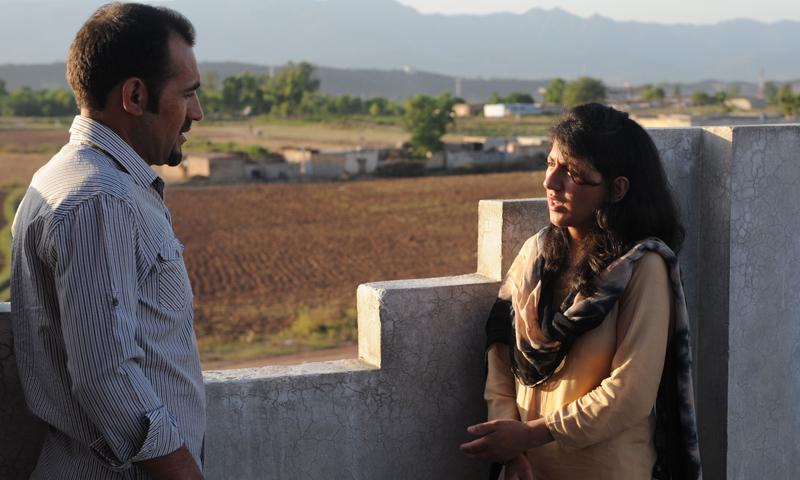 In this picture taken on June 4, 2013 Pakistani female climber Samina Baig (R) speaks with her brother Mirza Ali at their residence in Islamabad. — AFP Photo