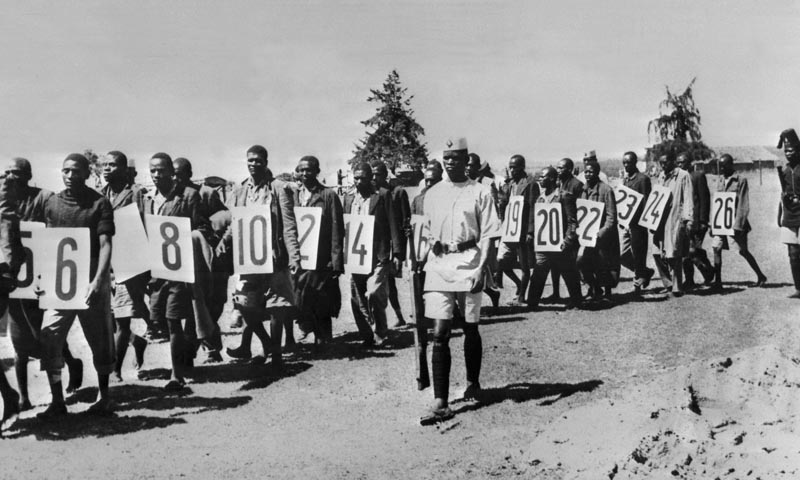 (FILES) In a file picture taken in April 1953 captured suspected Mau Mau fighters are marched towards Githunguri court in Kenya at the time of the Mau Mau uprising against British colonial rule.  Britain was on June 5, 2013 expected to announce compensation for thousands of Kenyans who claim they were abused and tortured in prison camps during the 1950s Mau Mau uprising, according to a government source. The Foreign Office (FCO) last month confirmed that it was negotiating settlements for claimants who accuse Briti