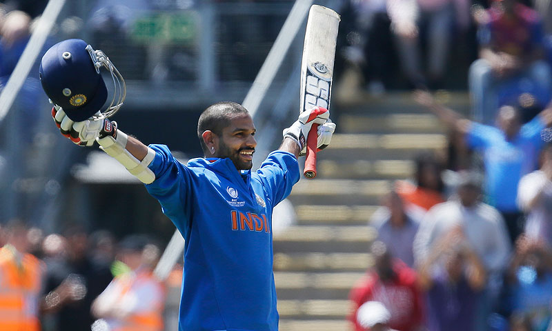 India's Shikhar Dhawan reacts as he reaches 100 runs not out. -Photo by AP