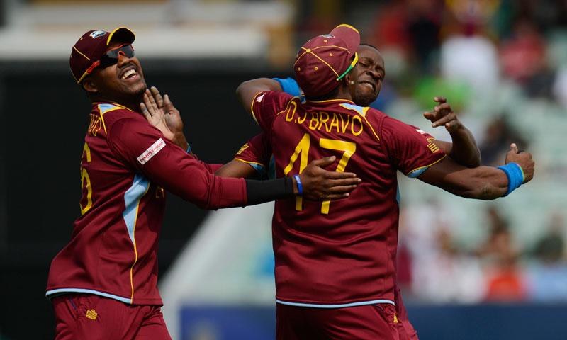 West Indies celebrate an early wicket. — Reuters
