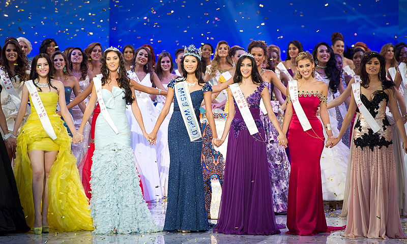 In this photograph taken on August 18, 2012, shows (front L-R) Miss Thailand Vanessa Herrmann,  second place Miss Wales Sophie Moulds, Miss Wold 2012 winner Yu Wenxia of China, Miss Australia Jessica Kahawaty, Miss Brazil Mariana Notarangelo and Miss India Vanya Mishra celebrate following the Miss World 2012 ceremony in Ordos, China. — AFP Photo