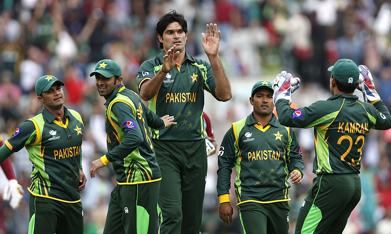 Irfan, center, celebrates the wicket of West Indies' Johnson Charles. -Photo by AP