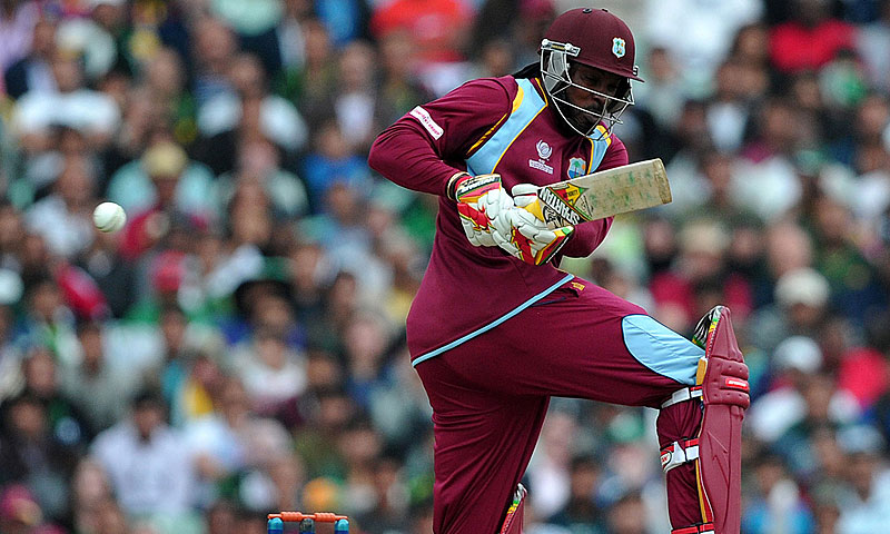Chris Gayle plays a shot. -Photo by AFP