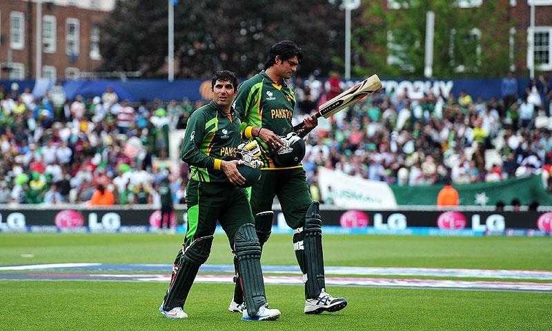 Misbah and Irfan walk back after Pakistan were dismissed. -Photo by AFP