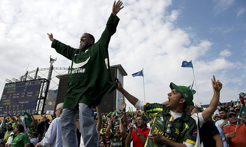 Pakistan fans cheer during the match. -Photo by AFP