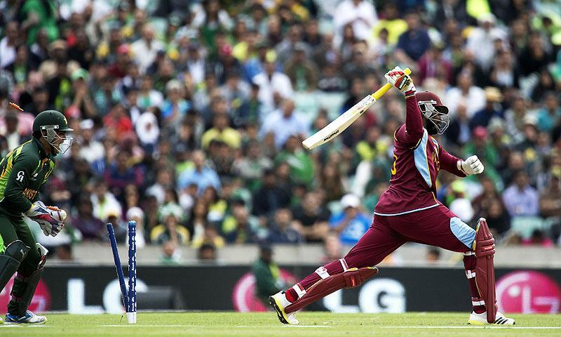 Chris Gayle is bowled by Saeed Ajmal. -Photo by AFP