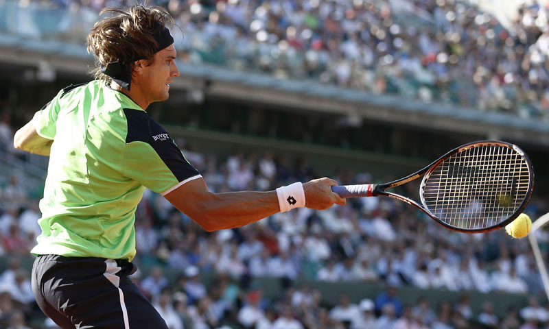 Ferrer hits a forehand. — AFP Photo