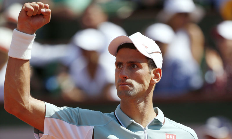 Djokovic celebrates his fourth set comeback. —AFP Photo