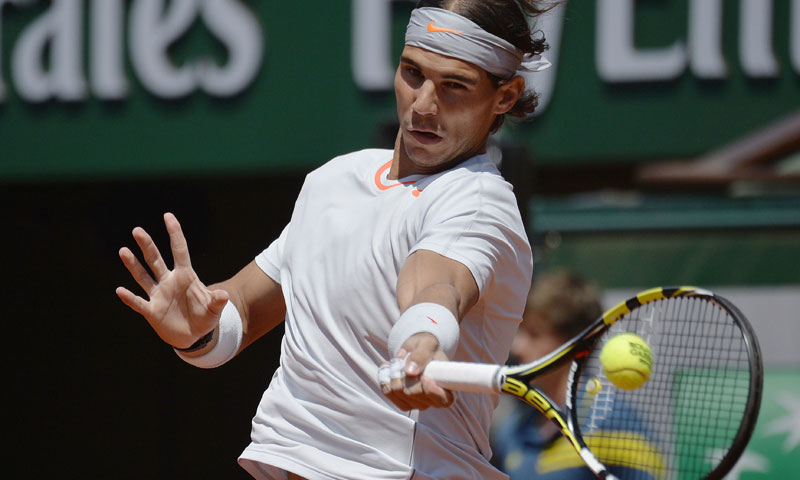 Nadal hits a forehand. — AFP Photo