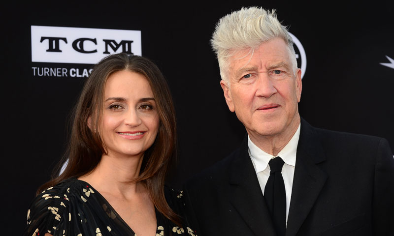 David Lynch and his wife Emily Stofle pose on arrival. — AFP Photo