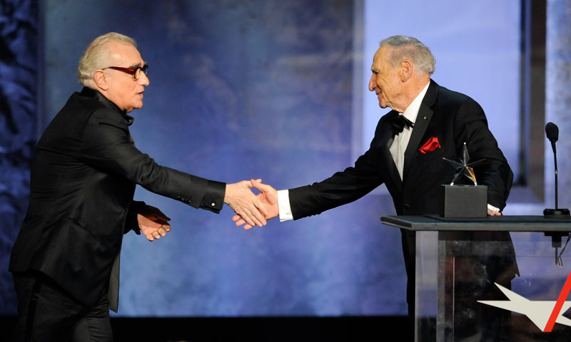 Honoree Mel Brooks, right, shakes hands with presenter Martin Scorsese. — AP Photo