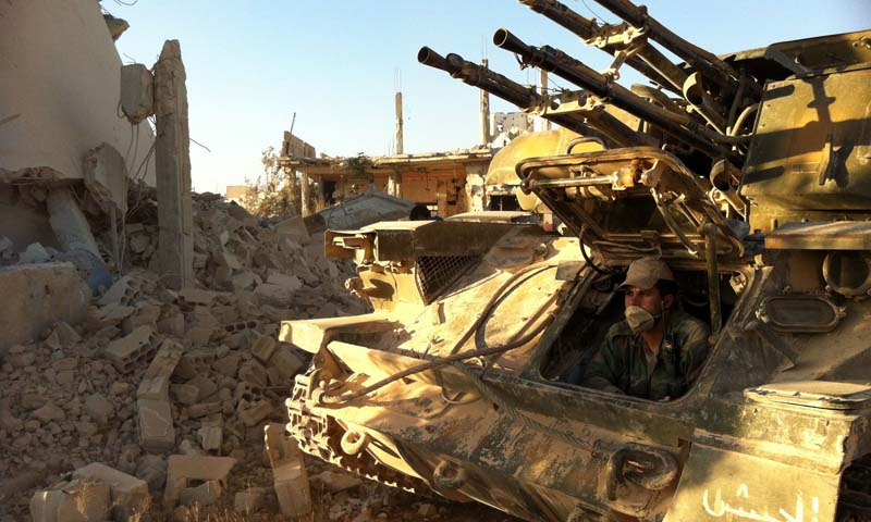 A Syrian army soldier sits in his tank in the southwestern neighbourhood of the Syrian city of Qusayr. -  AFP Photo/File
