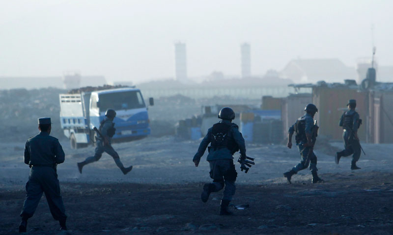 Afghan police arrive at the site of an attack in Kabul on June 10, 2013.—Photo by Reuters