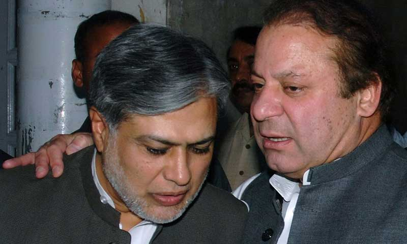 Finance Minister Ishaq Dar with Prime Minister Nawaz Sharif. — Photo by AFP