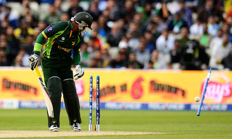 Imran Farhat is bowled by South Africa's Chris Morris. -Photo by Reuters