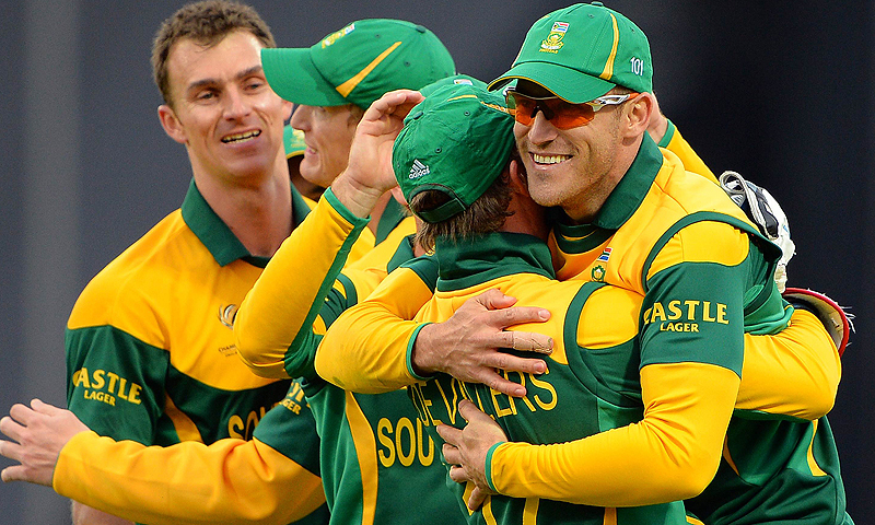 South Africa celebrate after taking a wicket. -Photo by AFP