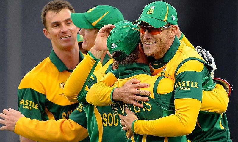 South Africa celebrate taking a wicket. -Photo by AFP