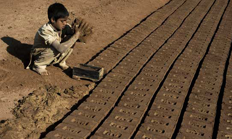 Poverty forces kiln labourers' parents to include their children in the work. — AFP/File photo.