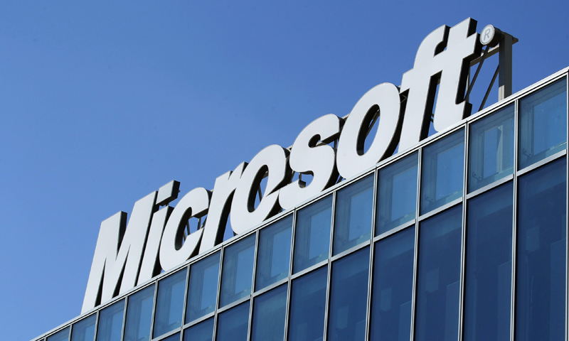 The Microsoft logo is seen at their offices in Bucharest March 20, 2013. Microsoft Corp said on Tuesday that allegations of potential bribery by employees in China, Romania and Italy should be reviewed by U.S. agencies and its own compliance unit, but declined to address the specifics of any cases.   REUTERS/Bogdan Cristel (ROMANIA - Tags: BUSINESS SCIENCE TECHNOLOGY LOGO)