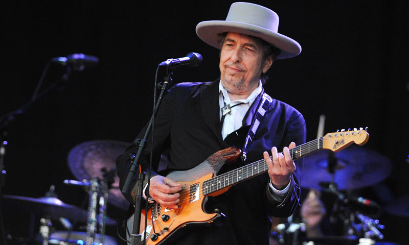 A picture taken on July 22, 2012 in Carhaix-Plouguer, western France shows US legend Bob Dylan performing on stage during the 21st edition of the Vieilles Charrues music festival. —AFP (File) Photo