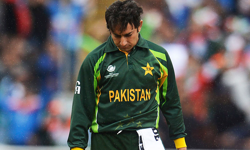 Ajmal reacts during the match. -Photo by Reuters