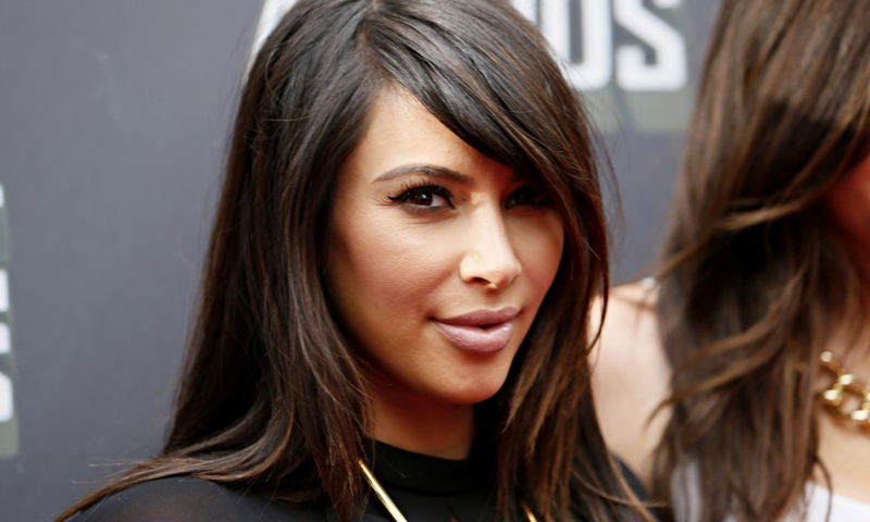 Socialite Kim Kardashian arrives at the 2013 MTV Movie Awards in Culver City, California April 14, 2013. — Reuters Photo