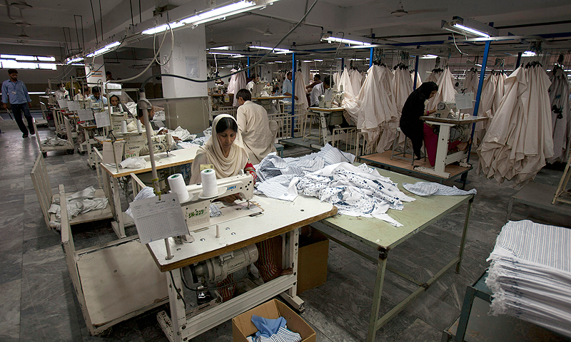 Employees work at a textile factory partially run by privately-produced power in Faisalabad.