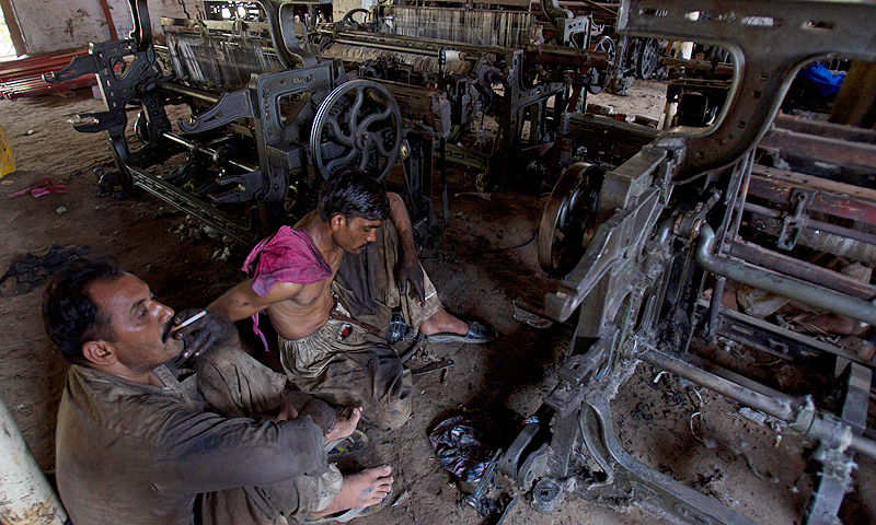 Workers take a smoke break as they dismantle loom machines in Faisalabad, to sell as scrap metal at a textile factory which closed due to power shortages. Kurram Mukhtar, head of Sadaqat Limited, one of Pakistan's leading textile manufacturers, said that from 2006 to 2010 many companies in the city and surrounding area were bankrupted by the power crisis. Owners who survived decided they needed energy independence.