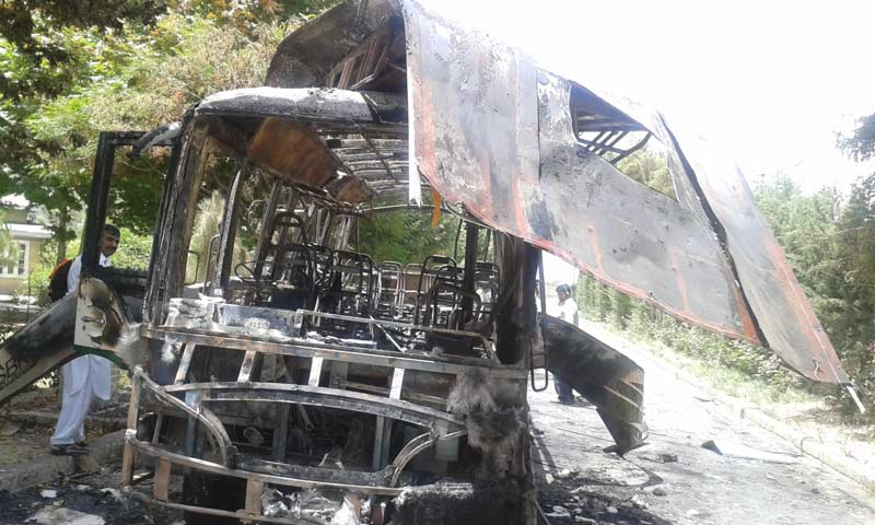 The charred remains of the bus that had been blown up by a suicide bomber. -Photo by Syed Ali Shah