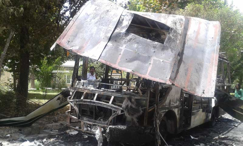 Another photograph of the destroyed bus. -Photo by Syed Ali Shah