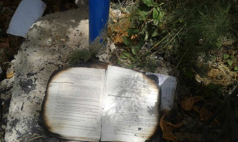 Another photograph of a burned book from the site. - Photo by Syed Ali Shah