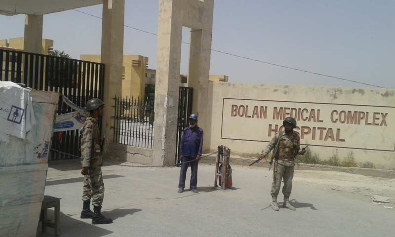 Security guards at the Bolan Medical College Hospital. -Photo by Syed Ali Shah