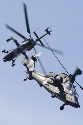Eurocopter Tiger H61 helicopters take part in a flying display, during the opening of the 50th Paris Air Show, at the Le Bourget airport near Paris, June 17, 2013. The Paris Air Show runs from June 17 to 23. — Reuters Photo