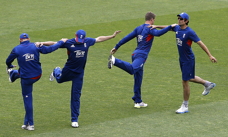 England's players stretch during a training session at the Oval in London on Tuesday. -Photo by AP
