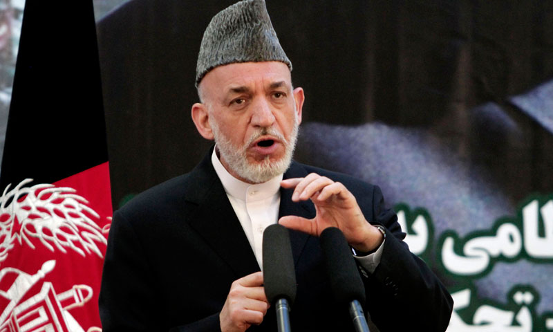 Photo shows Afghan President Hamid Karzai speaking at a press conference at a military academy on the outskirts of Kabul, Afghanistan, Tuesday, June 18, 2013. —AP Photo