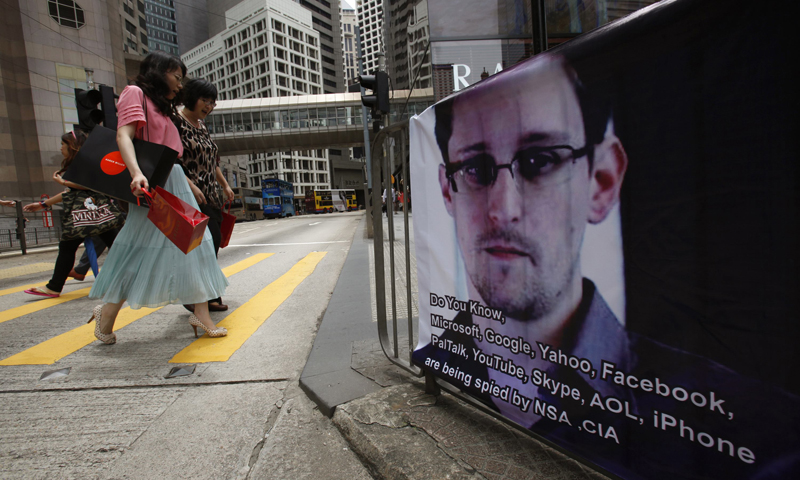 A poster supporting Edward Snowden, a former contractor at the National Security Agency (NSA) who leaked revelations of U.S. electronic surveillance, is displayed at Hong Kong's financial Central district June 17, 2013. — Reuters Photo.