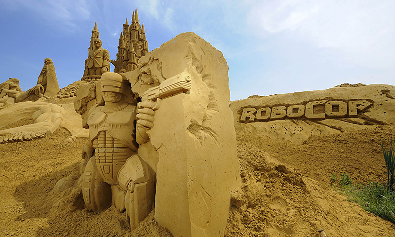 A sand sculpture representing the Robocop movie's character is on display during the Sand Sculpture Festival in Blankenberg on June 18, 2013. — AFP Photo