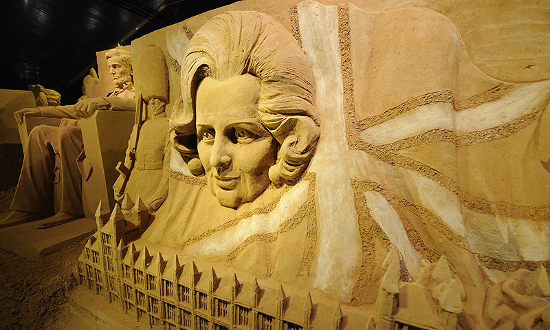 Sand sculptures representing the Lincoln Memorial (L) and Margareth Thatcher are on display during the Sand Sculpture Festival in Blankenberg on June 18, 2013. — AFP Photo