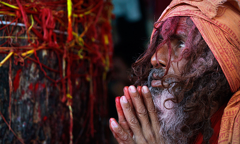A Sadhu or Hindu holy man prays at the Kamakhya temple in Gauhati, India, Wednesday, June 19, 2013. — AP Photo