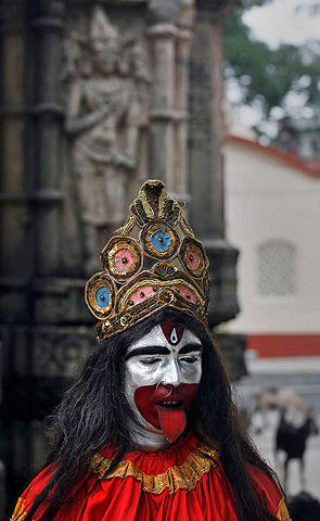 A Hindu holy man dressed like Goddess Kali stands at the Kamakhya temple in Gauhati, India, Wednesday, June 19, 2013. — AP Photo