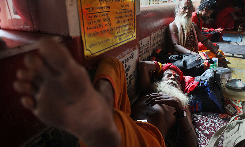 Sadhus or Hindu holy men rest at Kamakhya temple in Gauhati, India, Wednesday, June 19, 2013. — AP Photo