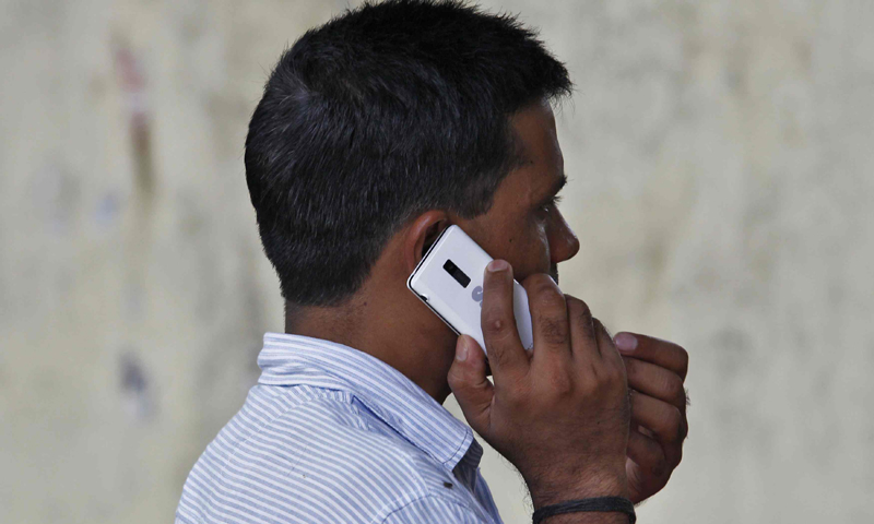 A man speaks on a mobile phone at a marketplace in New Delhi June 18, 2013. India has launched a wide-ranging surveillance programme that will give its security agencies and even income tax officials the ability to tap directly into e-mails and phone calls without oversight by courts or parliament, several sources said. — Reuters Photo
