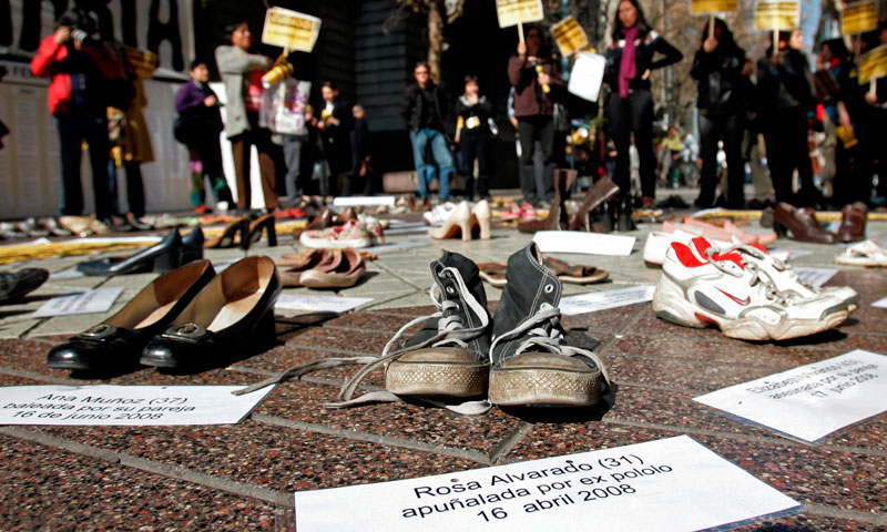 "In this Thursday, July 30, 2009 file photo, shoes representing female victims of violence are displayed by protesters from the Chilean Network Against Domestic and Sexual Violence in Santiago. The sign at bottom reads in Spanish ""Rosa Alvarado, 31, stabbed by ex-boyfriend, 16 April 2008."" About a third of women worldwide have been physically or sexually assaulted by a former or current partner, according to the first major review of violence against women. - Photo by AP"