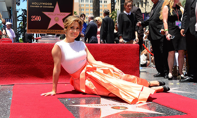 International superstar Jennifer Lopez poses beside her just unveiled star in Hollywood.–AFP Photo